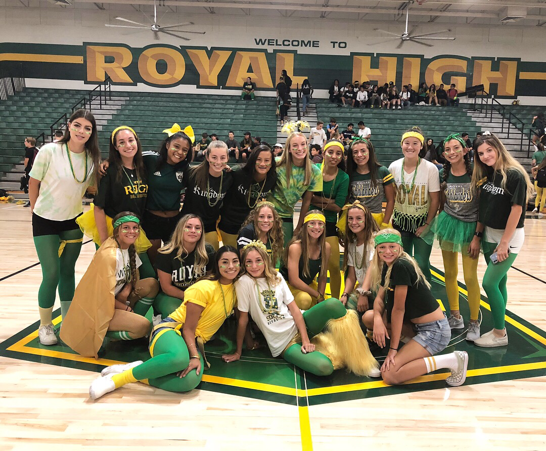 Royal girls soccer coming together after winning the dance battle.