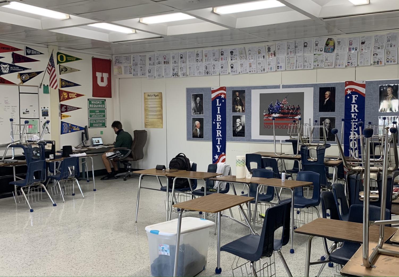History teacher Emmett Furlong working in his empty classroom due to coronavirus.