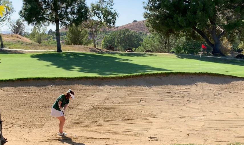 Senior+Madi+Decker+hits+out+of+the+bunker+while+being+socially+distanced+and+taking+COVID+19+safety+precautions.