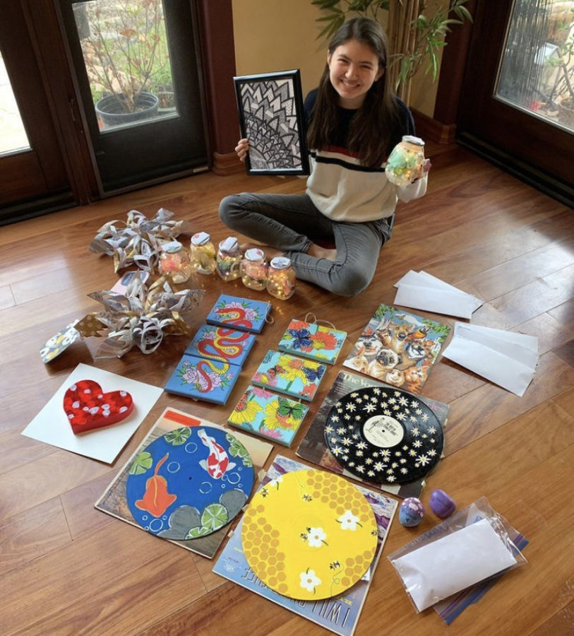 Junior Raquel Kanalz with gifts collected from students who participated in Project Alice.