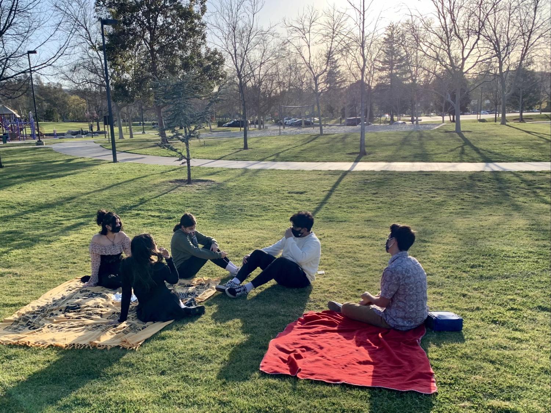 Juniors Malia McMillan, Abigail Jiwanmall, Pearl Spaho, Dev Matharu, and Michael Cano at Rancho Madera Community Park for the Junior Class Picnic.