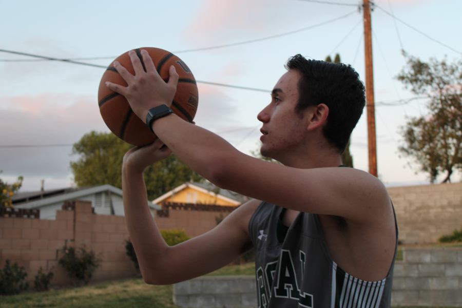 Justin+Fuchs%2C+JV+basketball+player%2C++practicing+for+the+game+against+Buena+Vista+on+Friday%2C+3%2F26.+++It+was+through+P.E.+that+he+first+learned+of+it%2C+and+has+been+pursuing+basketball+ever+since.+